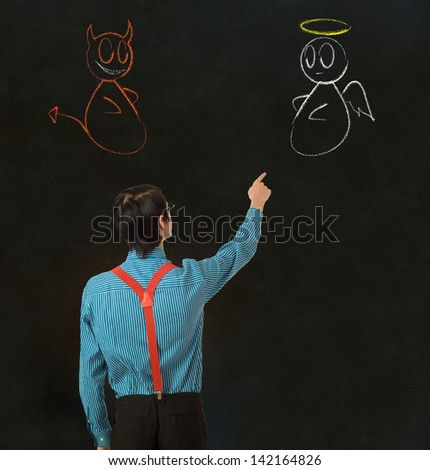 Nerd geek businessman, student or teacher with angel or devil chalk decision to make - stock photo