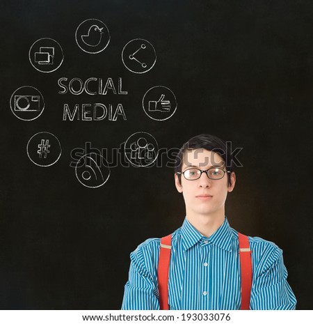 Nerd geek businessman with computer social media network icons on blackboard background - stock photo