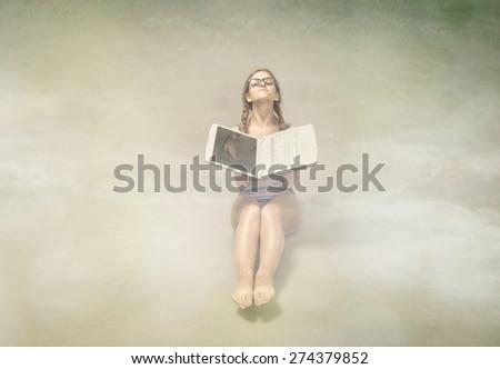nerd girl sun bathing with notebook - stock photo