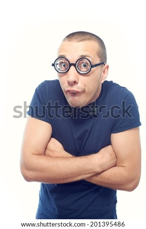 Nerd guy in eyeglasses and bow tie hugging himself - stock photo