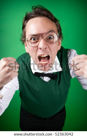 nerd guy is screaming and making a face - stock photo