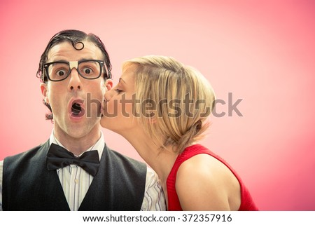 Nerd man boyfriend kissed by his girlfriend love portrait for valentine day - stock photo