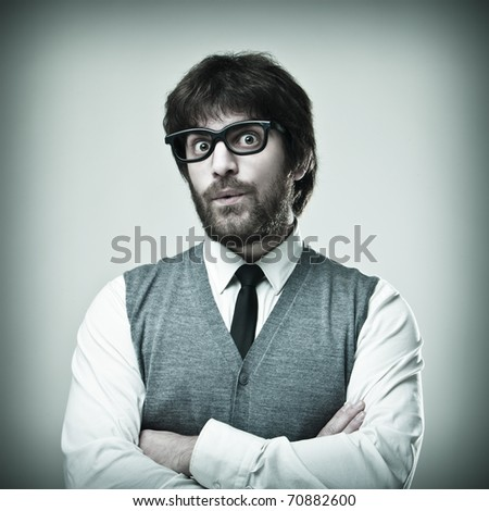 Nerd man with glasses and tie - stock photo