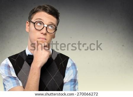 Nerd. Nerd Student Thinking Hard with Retro Glasses - stock photo