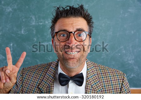 Nerd silly retro man teacher with braces funny expression winner victory finger gesture - stock photo