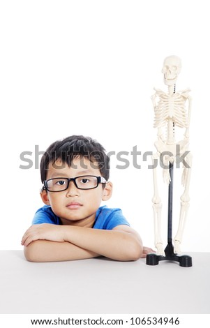 Nerd student at class of human anatomy, shot at laboratory isolated on white