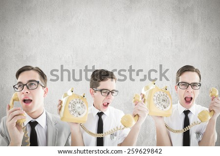 Nerdy businessman with phone against white and grey background - stock photo