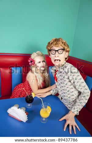 Nerdy guy escaping from his girlfriend, similar available in my portfolio - stock photo