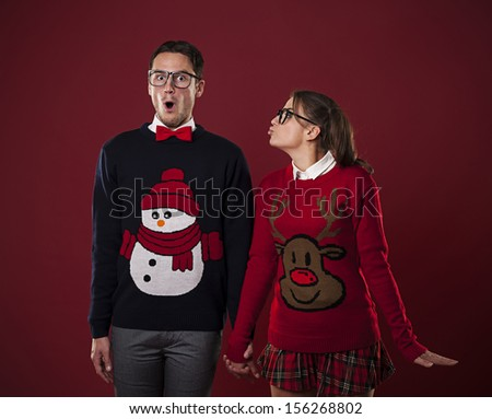 Nerdy woman kissing shocked man  - stock photo