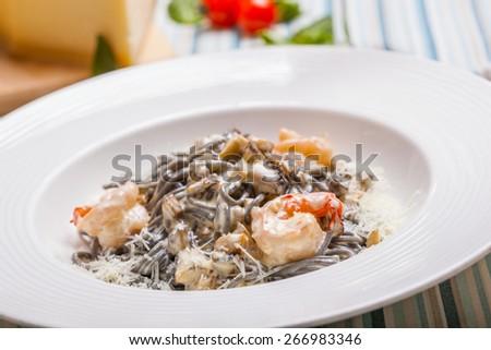 Neri pasta with shrimp and mushrooms - stock photo