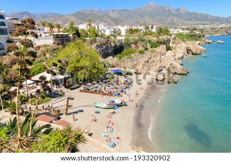 Nerja beach, famous touristic town in costa del sol, Malaga, Andalusia, Spain. - stock photo