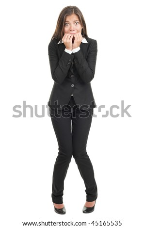 Nervous scared woman biting her nails. Funny asian businesswoman isolated in full length on white background. Mixed caucasian / chinese model. - stock photo