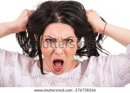 Nervous woman yelling and pull  her hair isolated on white background