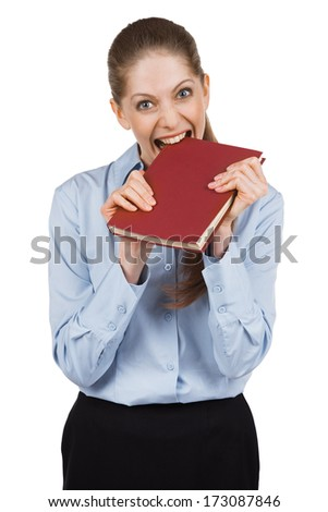 Nervous young woman tries to bite a book - stock photo