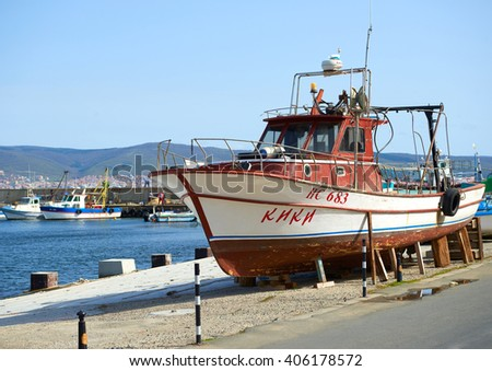 Nessebar, Bulgaria - April 01, 2016: Old wooden fishing boat in port of nessebar, ancient city on the Black Sea coast of Bulgaria