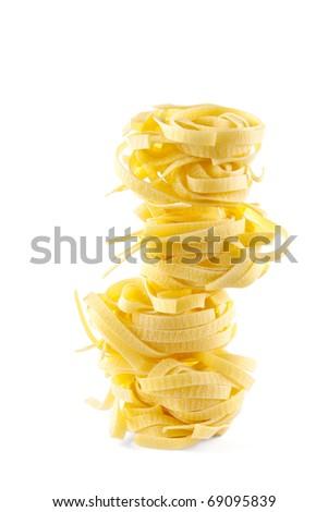 nest pasta pyramid on white - stock photo