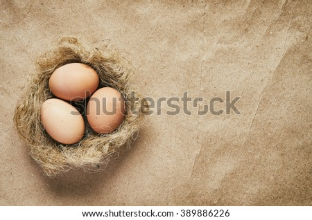 Nest with eggs on eco craft paper background. Easter postcard template. Space for text, copy, lettering. - stock photo
