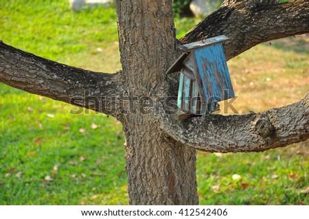 Nesting box hanging on the tree, wooden nesting boxes,Birdhouse  - stock photo