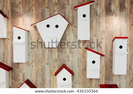Nesting boxes on the wall. Neighborhood and property concept - stock photo