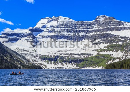 Nestled in a glacial basin, Cameron Lake is a hidden jewel high in the Canadian Rockies at Waterton Lakes National Park. - stock photo