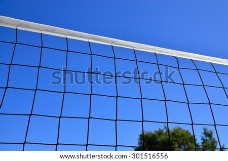 Net for beach volleyball against the blue sky