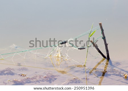 net in the water - stock photo