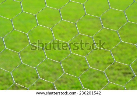 Net of goal on green background
