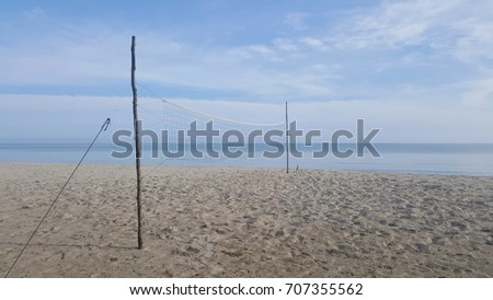 net on the beach and blue sky background