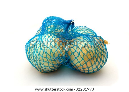 Net with fresh onions on a white background - stock photo