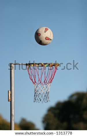 Netball about to go into the goal, on a fine autumn morning at Lincoln, New Zealand. - stock photo