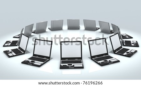 Netbook computers with blank screen stacked in circle isolated on white background - stock photo