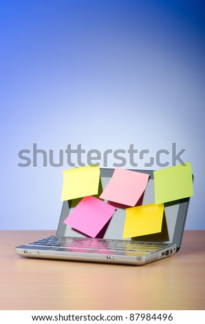 Netbook with reminder notes - stock photo