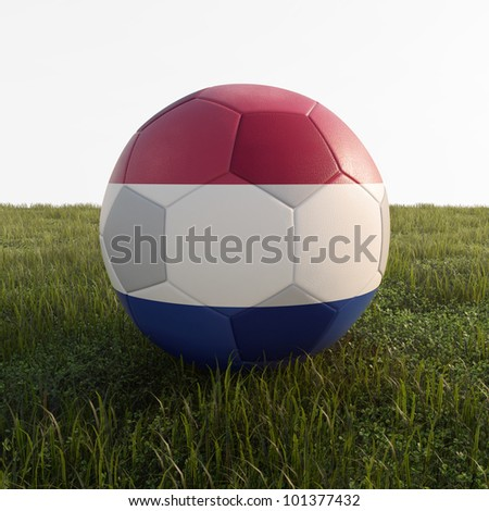 netherland soccer ball isolated on grass - stock photo