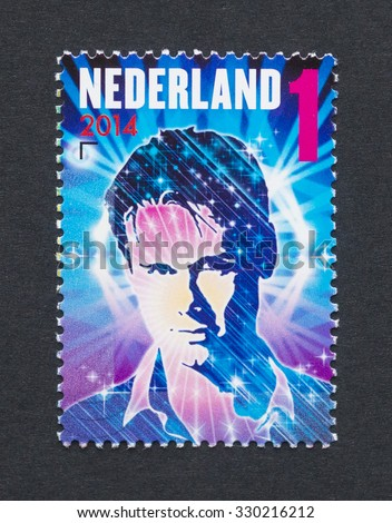 NETHERLANDS - CIRCA 2014: a postage stamp printed in Netherlands showing an image of dj Armin Van Buuren, circa 2014.  - stock photo