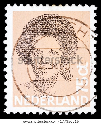 NETHERLANDS - CIRCA 1980: A stamp printed in the Netherlands shows image of Queen Beatrix, circa 1980  - stock photo
