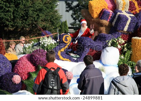 NETHERLANDS – CIRCA APRIL 2007: Spectators watch the Parade of Flowers called Bloemencorso which is held to celebrate the Day of Spring circa April 2007 in The Netherlands.