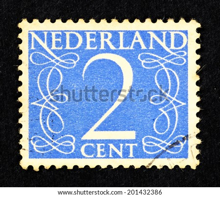 NETHERLANDS - CIRCA 1955: Blue color postage stamp printed in Netherlands with a value of 2 cent. - stock photo