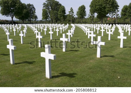 NETHERLANDS - MARGRATEN - CIRCA JUNE 2014: Crosses on military graves of fallen U.S. soldiers at the Netherlands American Cemetery and Memorial.