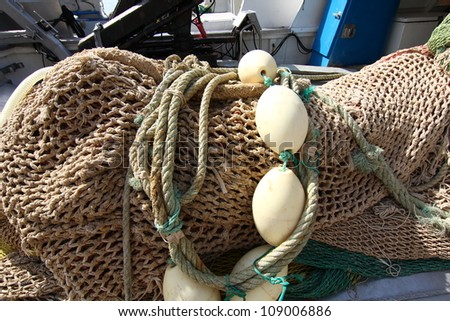 nets and fishing gear at sea - stock photo