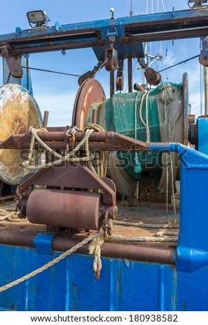 Nets and rigging of an iron fishing trawler - stock photo