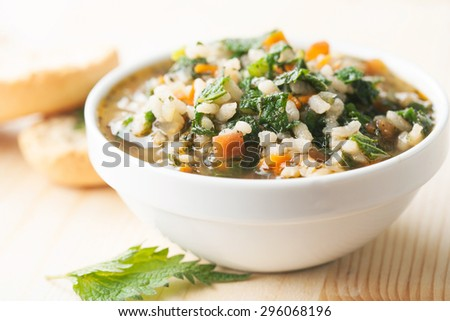 Nettle soup with rice - stock photo
