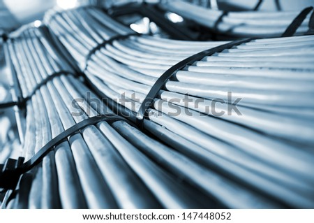 Network and power cables, abstract flow of information in internet networks - stock photo
