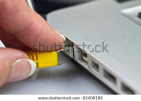Network cable get plug in. - stock photo