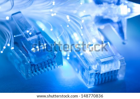 Network cables closeup with fiber optic. Shallow depth of field. Selective focus.  - stock photo
