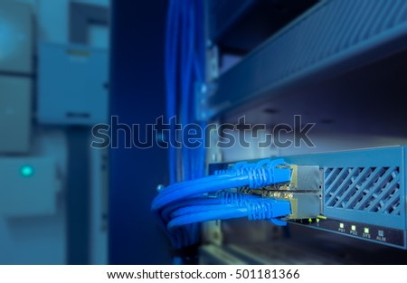 network cables connected to network gigabit switch in a datacenter room