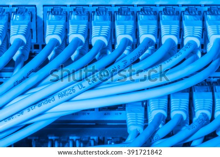 network cables connected to switch - closeup of data center hardware - stock photo