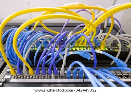 Network cables connected to the server - Switch and cable in data center - stock photo