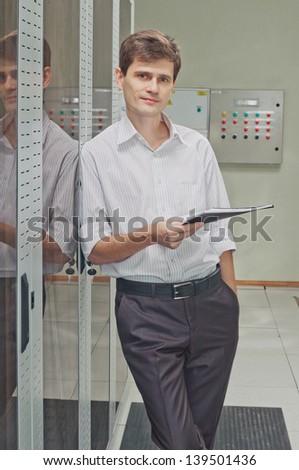 Network engineer  in corridor server room - stock photo