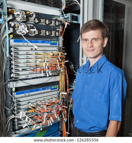 Network engineer in server room - stock photo