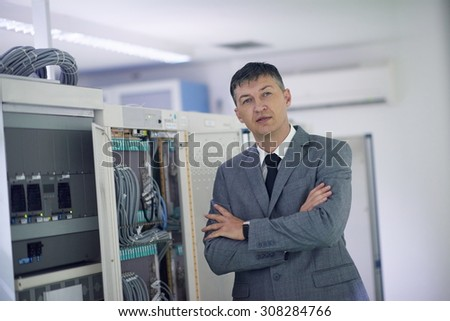 network engineer working in  server room, corporate business man - stock photo
